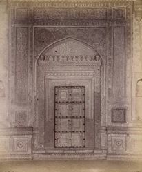 Close view of west door of Ibrahim Rauza Tomb, with surrounding decorative work, Bijapur